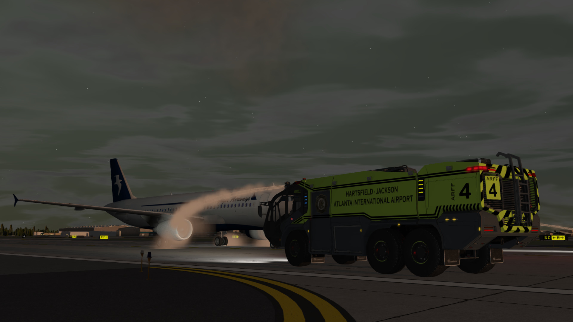 Rosenbauer Panther ARFF Truck extinguishing an aircraft engine fire during sundown at Atlanta Airport.
