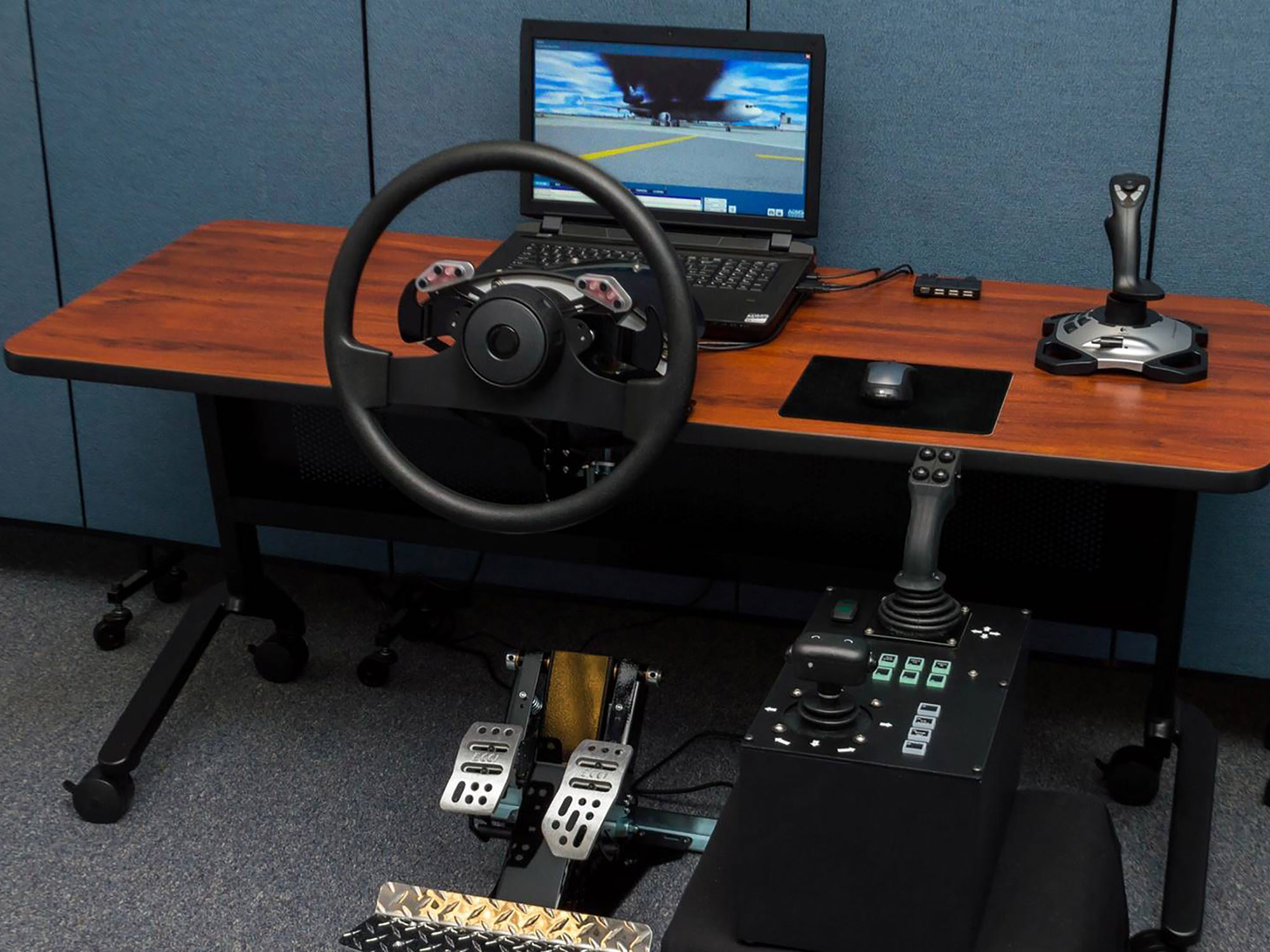 Desktop ARFF and Airport Drive Trainer consists of a generic steering wheel and controls packed in transportation cases.