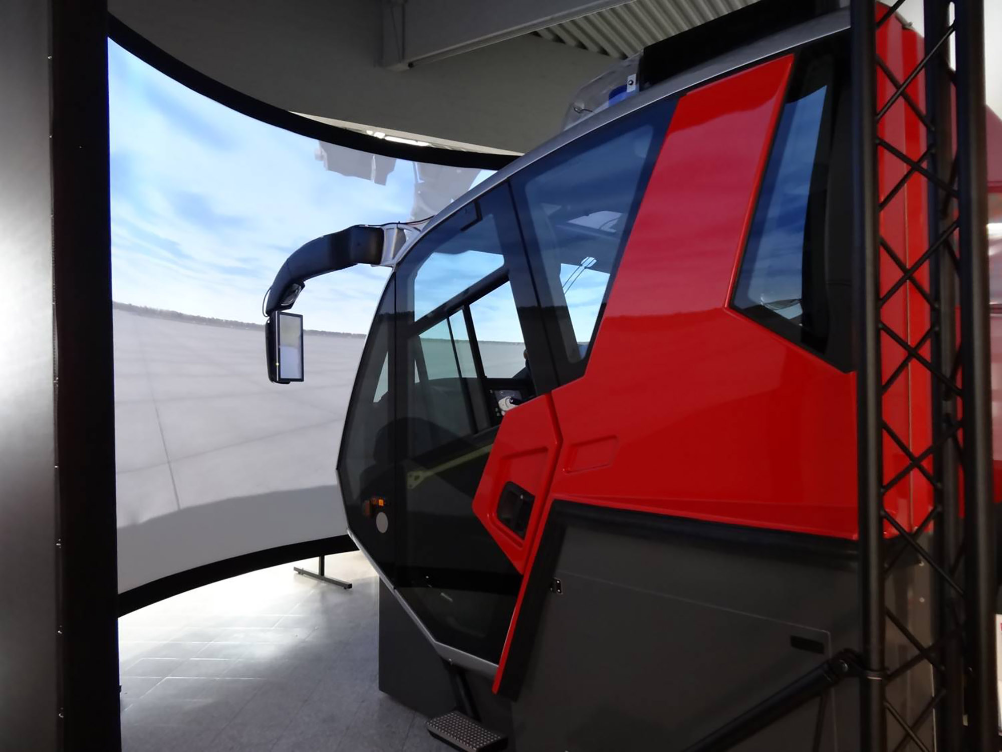 Full-sized Rosenbauer Panther Cabin with a 210-degree projection screen for full immersion to train ARFF Operations.
