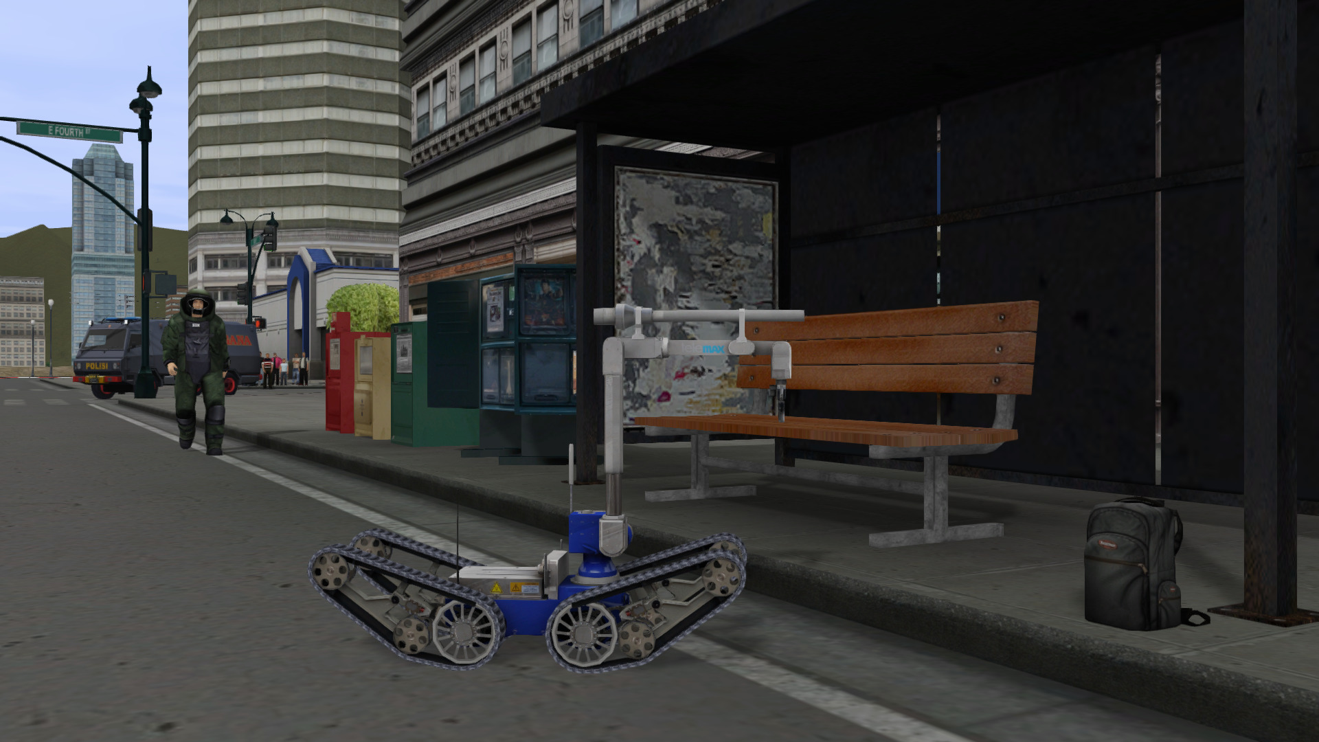 EOD Bot moving in closer to investigate a possible IED at a bus stop.